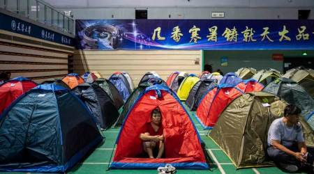 In China, college-going students have their parents in tents next door
