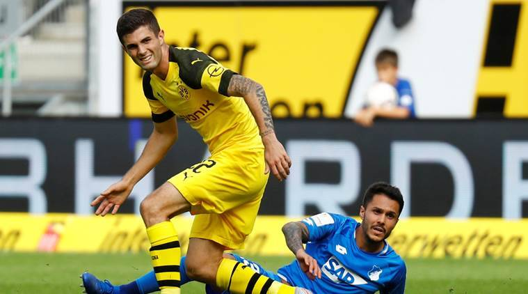 Christian pulisic again rescues 10 man borussia dortmund from first defeat