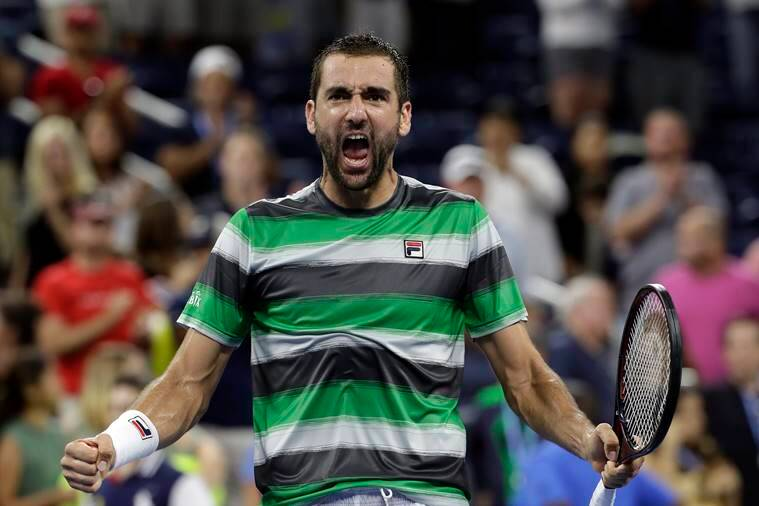 Marin Cilic of Croatia, celebrates his five set victory over Alex de Minau, of Australia, in a third-round tennis match at the U.S. Open tennis championship, Sunday, Sept. 2, 2018, in New York.