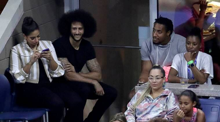 Former San Francisco 49ers NFL football quarterback Colin Kaepernick, second from top left, watches a third-round match between Serena Williams and Venus Williams at the U.S. Open tennis tournament