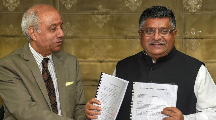 In this photo, Justice BN Srikrishna hands over the report to IT Minister RS Prasad. (PTI)