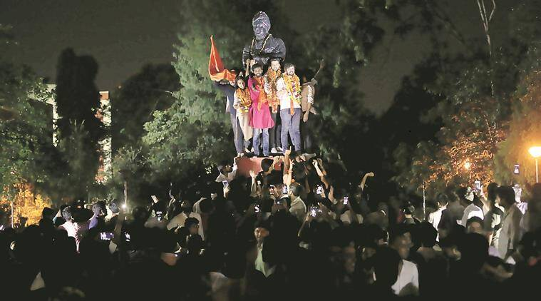 ABVP's winning candidates at the Vivekananda statue in Arts Faculty, Thursday. (Express photo/Tashi Tobgyal)