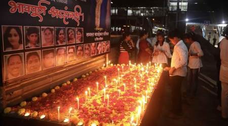Commuters, politicians pay tribute on first anniversary of Elphinstone stampede
