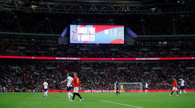 General view as the scoreboard indicates 9 minutes of added time during the England vs Spain match at Wembley