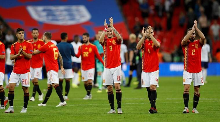 Spain's Marco Asensio, Saul Niguez, Nacho and Dani Carvajal applaud the fans at the end of the match