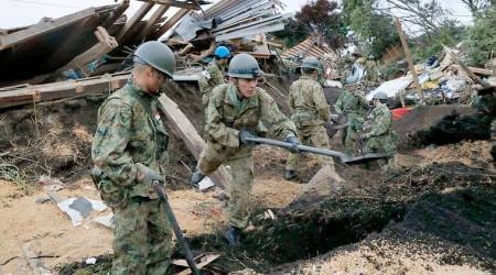 Death toll from Japan earthquake rises as rescuers dig throughlandslides