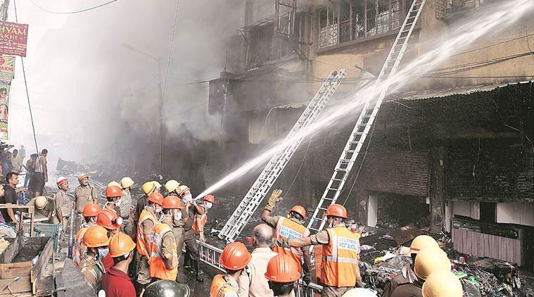 Firefighters were still engaged in dousing the fire, which left hundreds of shops gutted at Bagree Market. (Express photo/Partha Paul)