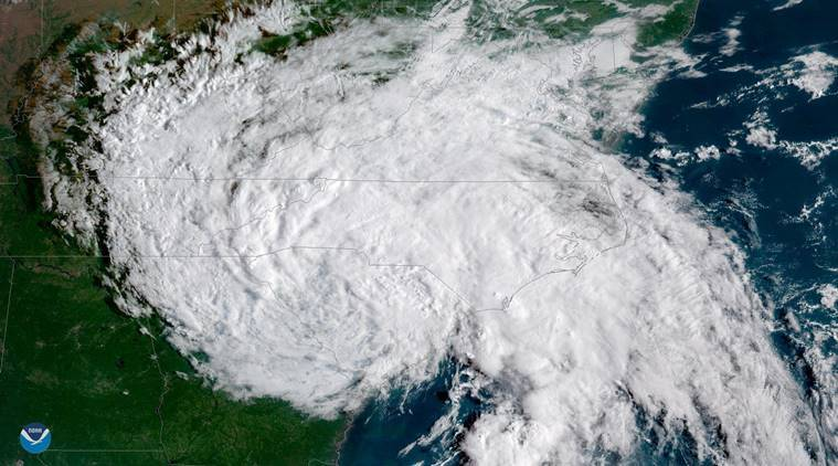 This satellite image provided by NOAA shows Tropical Depression Florence moving west across the United States on Sunday September 16