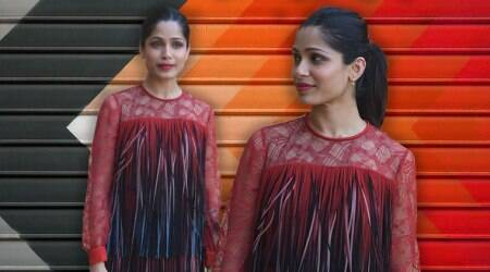 Freida Pinto disappoints in this red and black separates