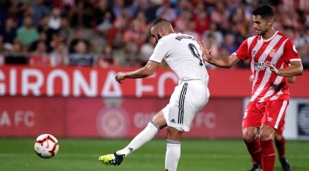 Real Madrid's Karim Benzema scores his side's 4th goal during the Spanish La Liga soccer match between Girona and Real Madrid at the Montilivi stadium in Girona
