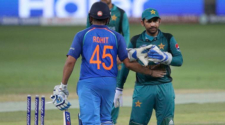India's captain Rohit Sharma, left, greets Pakistan's captain Sarfraz Ahmed as they leave the field at the end of the one day international cricket match of Asia Cup between India and Pakistan in Dubai