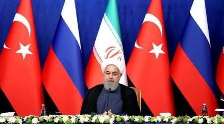 Iran's President Hassan Rouhani at a joint press conference with Russia's President Vladimir Putin and Turkey's President Recep Tayyip Erdogan in Tehran. (AP)