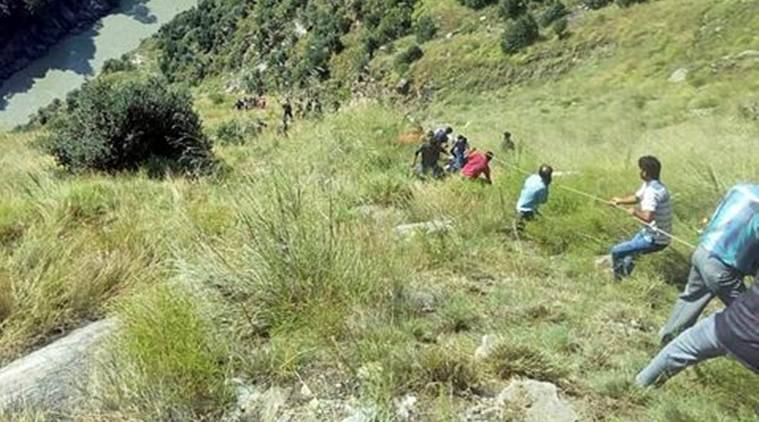 Rescuers try to reach the bus that fell into a gorge in Kishtwar, about 217 kilometers (135 miles) southeast of Srinagar, on Friday. (AP)