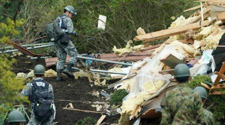 Japan quake toll up to 20 as rescuers dig through landslides