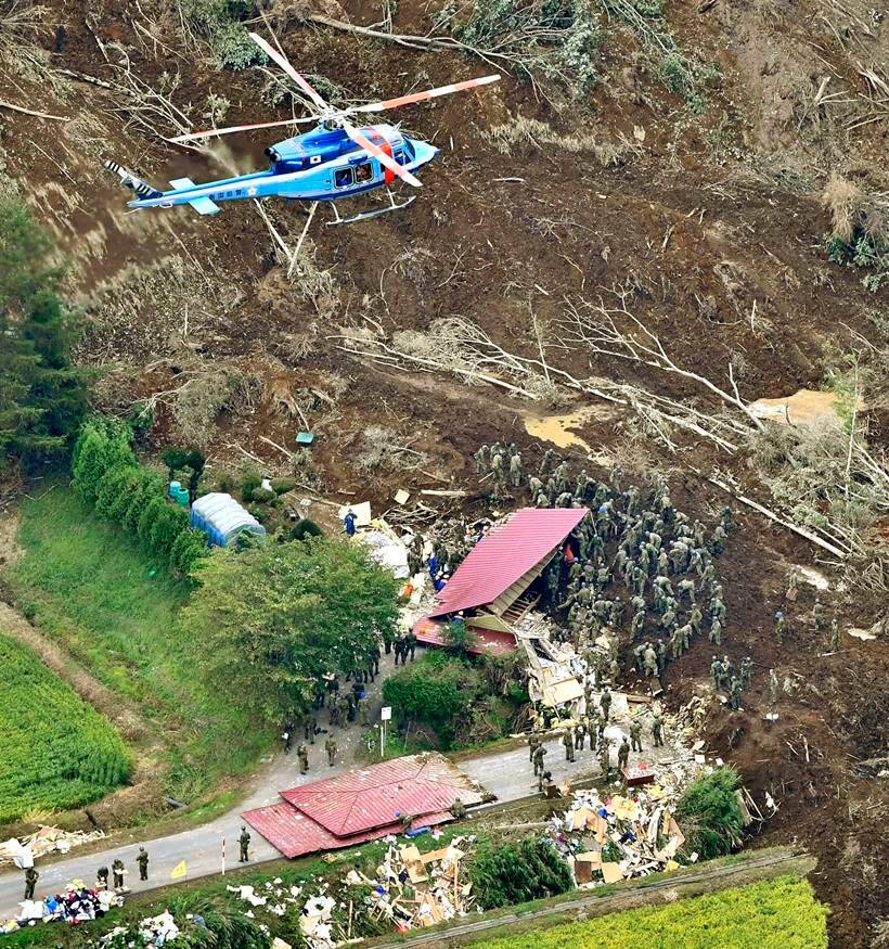 Japan earthquake toll rises as rescuers dig through landslides