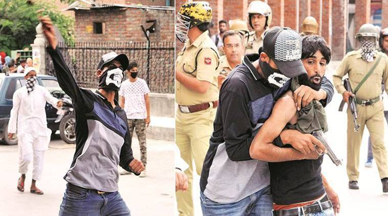 The masked man hurling stones during protest. (PTI)