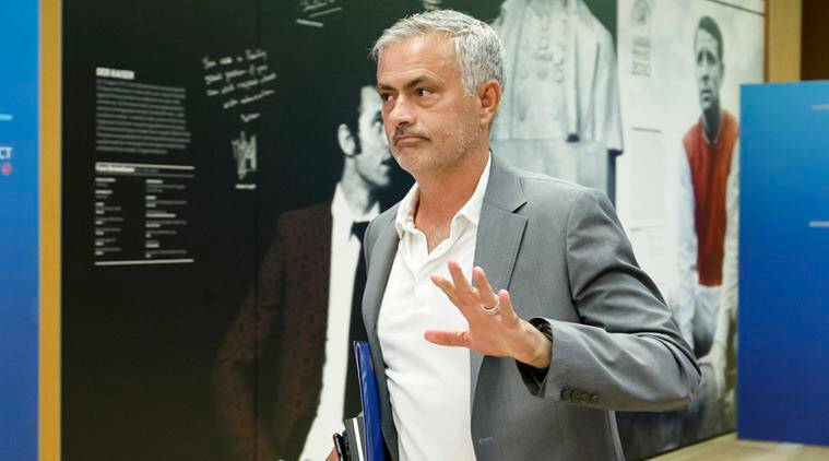 In this Sept. 4, 2018 photo Jose Mourinho, coach of Manchester United FC, leaves the meeting after the 2018 UEFA Elite Club Coaches Forum, at the UEFA headquarters in Nyon, Switzerland.