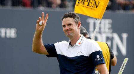 England's Justin Rose gestures to fans on the 18th during the final round