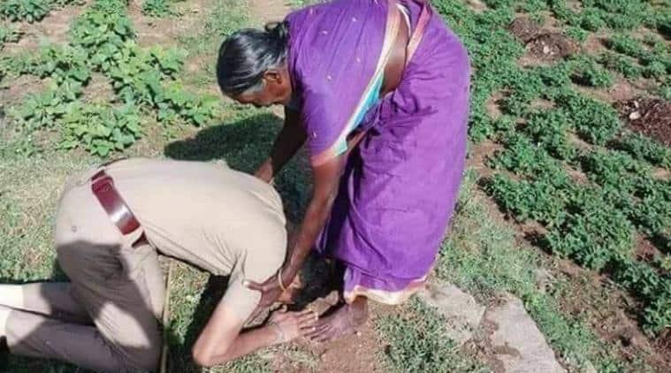police touching mother feet, cop bowing down to mother, cop salute mother, mother sacrifice karnataka cop, karnataka news, social media news, viral photo, indian express