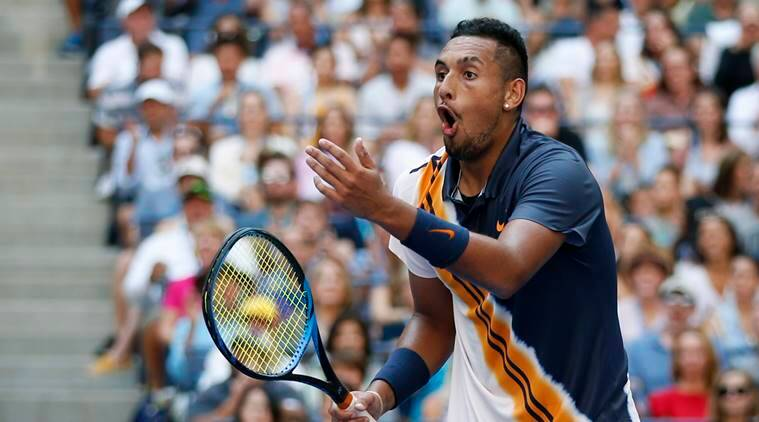 Nick Kyrgios, of Australia, reacts to a winning shot by winning shot by Roger Federer, of Switzerland, during the third round of the U.S. Open tennis tournament