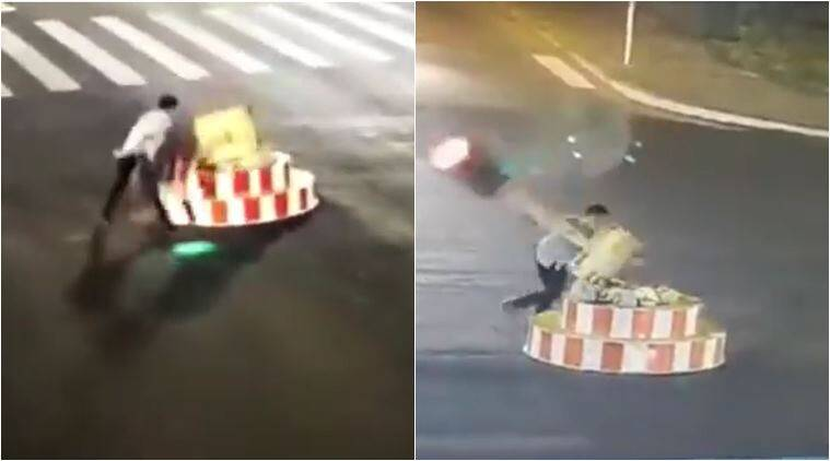 man breaks traffic signal, man knocks of traffic light, viral news, bizarre news, odd news, viral videos, funny videos, indian express, china funny news