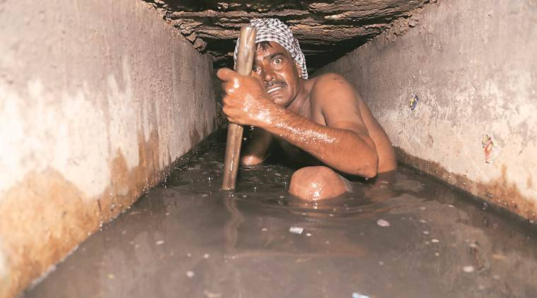 manual scavenger death, manual scavenging, MS Act 2013, SC/ST Act, New Delhi, Indian Express