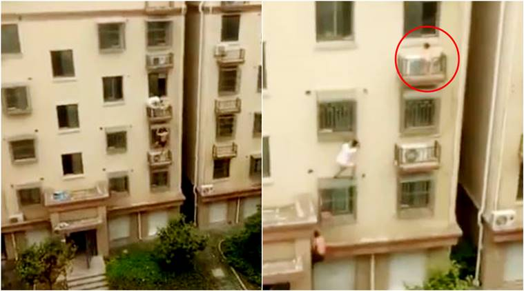 man saves child, man saves child china, man climbs building to save child, China, VIRAL VIDEOS, viral videos today,viral videos China. , video, world news, trending,