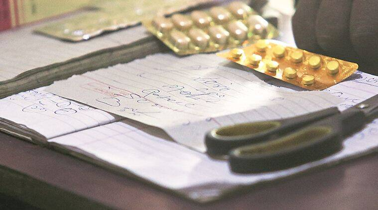 In Mewat, an unregistered medical practitioner writes a prescription. (Photo: Praveen Khanna)