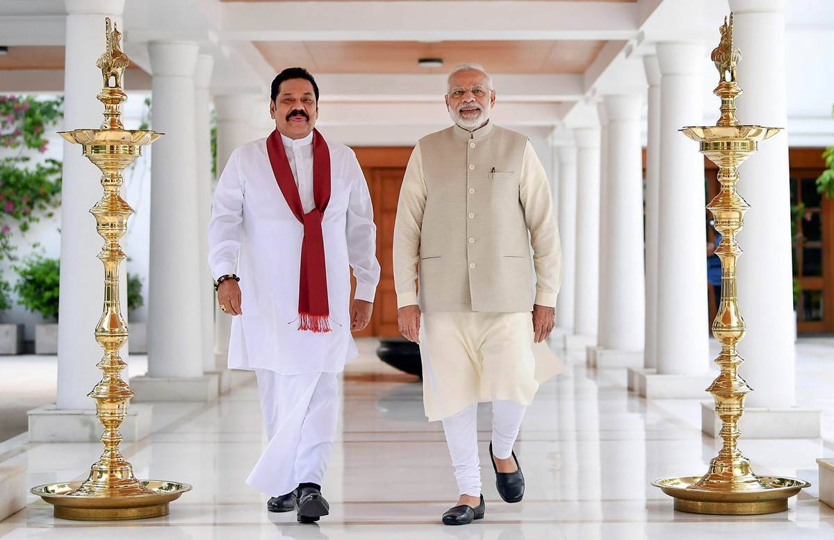 Prime Minister Narendra Modi with former Sri Lankan president Mahinda Rajapaksa in New Delhi on Wednesday. (PTI photo)