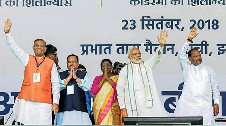 Prime Minister Narendra Modi with (L-R) Minister of State for Civil Aviation Jayant Sinha, Union Health Minister JP Nadda, Jharkhand Governor Droupadi Murmu and Chief Minister Raghubar Das wave at their supporters during the launch of Ayushman Bharat-National Health Protection Mission in Ranchi on Sunday. (PTI)