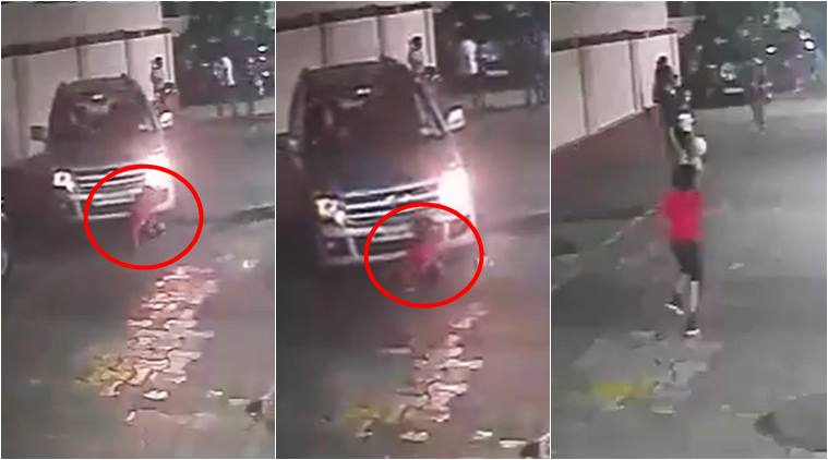 kid survive accident, run over by car child survives, accident cctv videos, miracle surviving accident, mumbai videos, indian express, viral videos