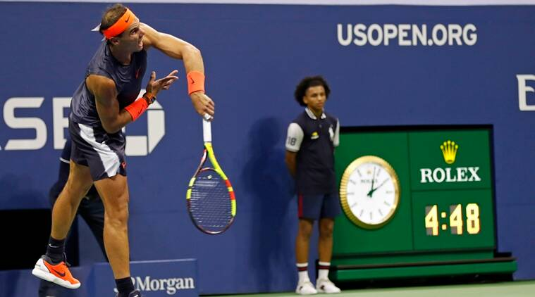 Rafael Nadal, of Spain, serves to Dominic Thiem, of Austria, during the quarterfinals of the U.S. Open tennis tournament, early Wednesday