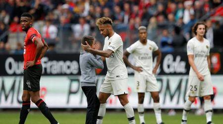 Paris St Germain's Neymar with a pitch invader