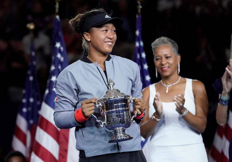 Naomi Osaka of Japan holds the U.S. Open trophy after beating Serena Williams of the USA in the women's final on day thirteen of the 2018 U.S. Open tennis tournament at USTA Billie Jean King National Tennis Center.