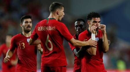 Portugal's Pepe celebrates with team mates after scoring their first goal