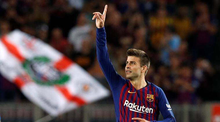Barcelona's Gerard Pique celebrates scoring their second goal against Girona in La Liga
