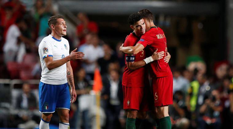 Portugal's Pepe celebrates while Italy's Andrea Belotti reacts after the match