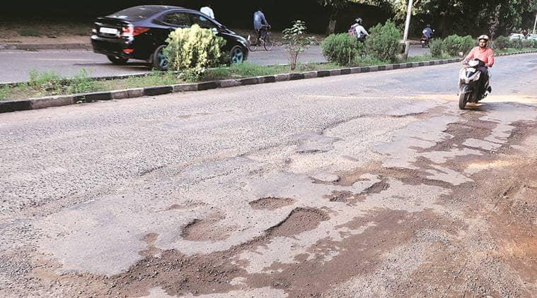 chandigarh roads, Chandigarh potholes, potholed roads, Chandigarh municipal corporation, chandigarh news, indian express