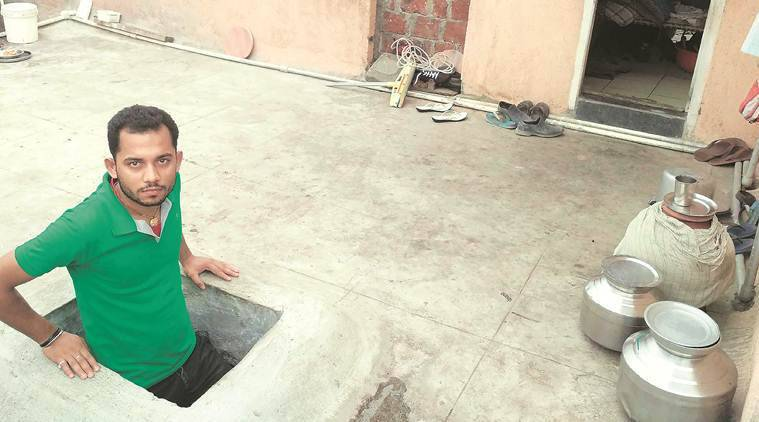 Raj Kumar Singh at his house on the second storey of a toilet block in Chinchwad. (Express photo)