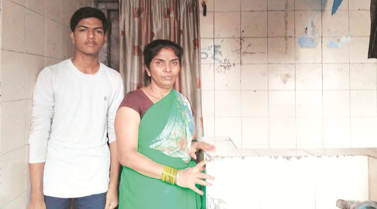 Raju Sawant's wife Sharada with her son at the Sinhagad Road lavatory. (Express photo)