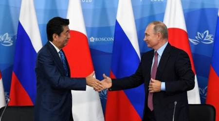 Russia's Vladimir Putin tells Japan's Shinzo Abe: 'Let's sign peace deal this year'