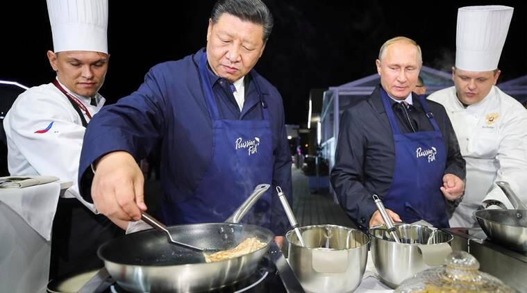 vladimir putin, xi jinping, putin xi make pancakes, xi putin cooking, russia china talks, east economic forum, world news, viral videos, indian express