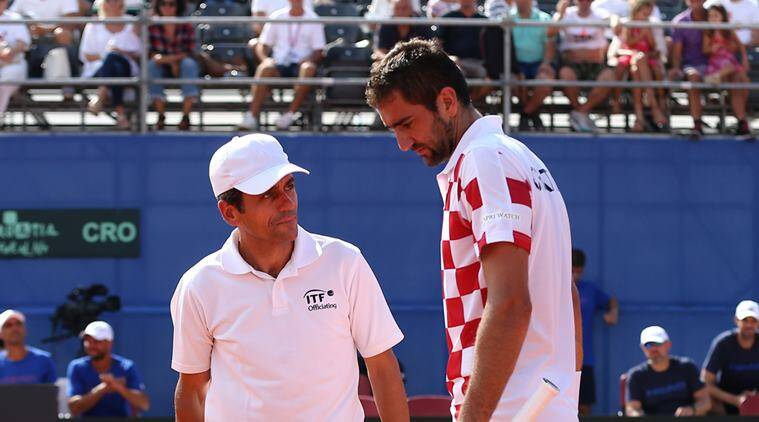 Croatia's Marin Cilic speaks with umpire Carlos Ramos during his match against Frances Tiafoe of the U.S.