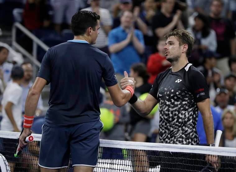 Milos Raonic, left, of Canada, shakes hands with Stan Wawrinka, of Switzerland, after Raonic won their third-round match at the U.S. Open tennis tournament, Friday, Aug. 31, 2018, in New York.