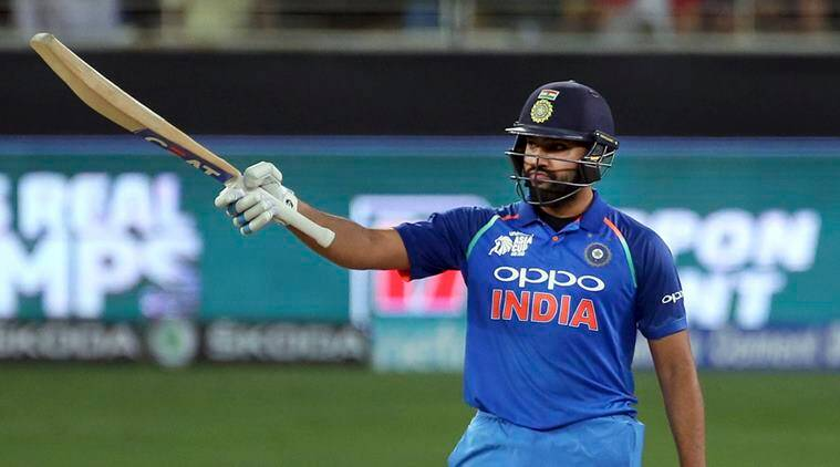 India's captain Rohit Sharma raises his bat to celebrate scoring fifty runs during the one day international cricket match of Asia Cup between India and Pakistan in Dubai, United Arab Emirates