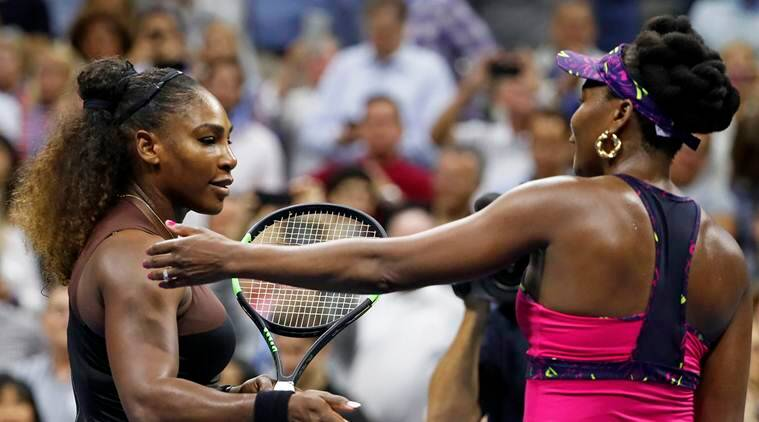 Serena Williams, left, meets her sister Venus Williams after their match during the third round of the U.S. Open tennis tournament
