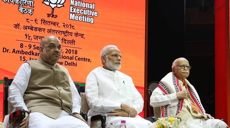 Prime Minister Narendra Modi with BJP leaders Amit Shah and LK Advani at the event in the national capital on Thursday.