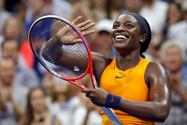 Sloane Stephens, of the United States, smiles after defeating Elise Mertens, of Belgium, during the fourth round of the U.S. Open tennis tournament Sunday
