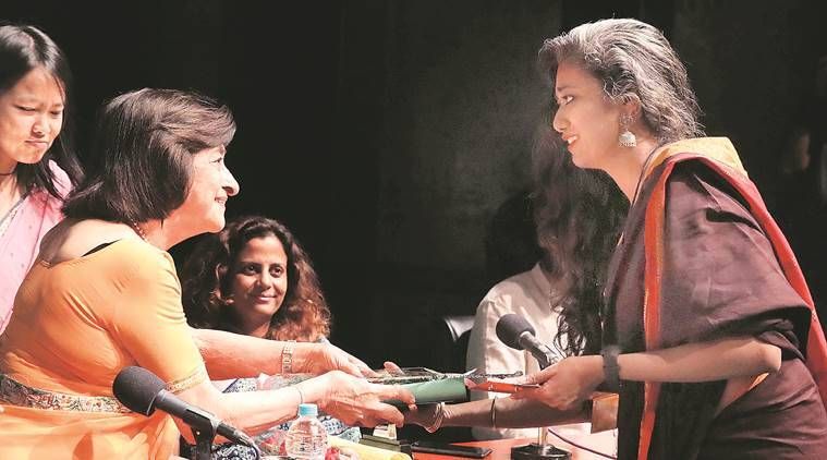Smita Nair receives the Cushrow Irani prize for Environmental Reporting from Threety Irani, in Kolkata. (Express photo/Partha Paul)