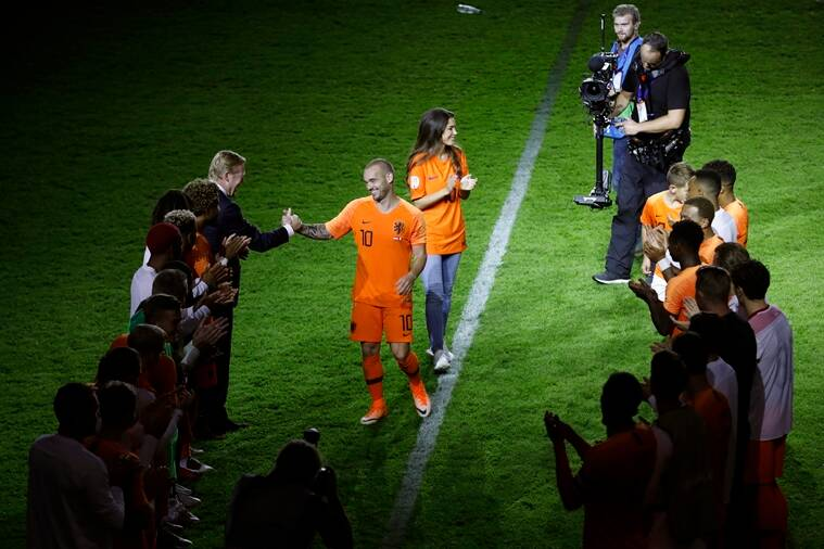 Wesley Sneijder of The Netherlands greets coach Ronald Koeman of The Netherlands as he retires from international soccer after the international friendly soccer match between The Netherlands and Peru at the Johan Cruijff ArenA in Amsterdam, Netherlands, Thursday